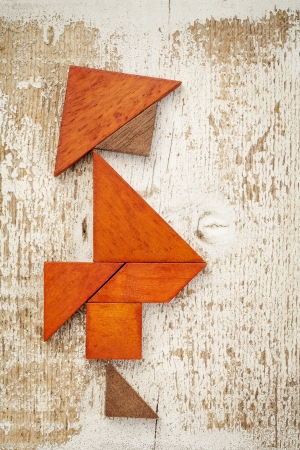 obesity concept - abstract figure of a fat man built from seven tangram wooden pieces, a traditional Chinese puzzle game,, rough white painted barn wood background Stock Photo - 21642267