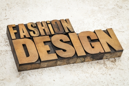 fashion  design  text in vintage letterpress wood type on a ceramic tile background Stock Photo - 21642297