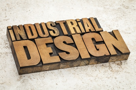 industrial design  text in vintage letterpress wood type on a ceramic tile background photo