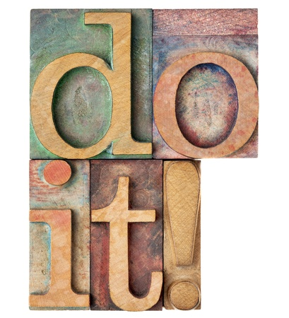 do it exclamation - motivation concept - isolated text in vintage wood letterpress printing blocks stained by color inks Stock Photo - 21921178