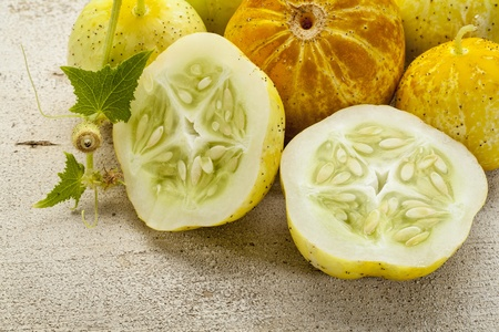 lemon (or apple) cucumbers on rough white painted wood surface Stock Photo - 21921181