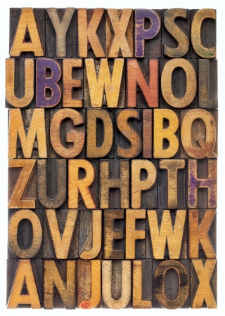 woodtype: random letters of alphabet - vintage letterpress wood type printing blocks scratched and stained by color inks Stock Photo