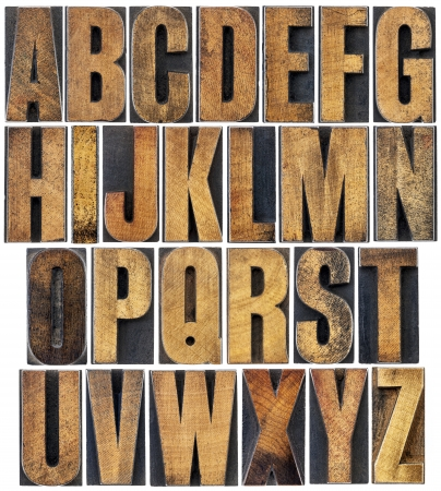 complete English alphabet - a collage of 26 isolated vintage wood letterpress printing blocks, scratched and stained by ink Stock Photo - 22443324