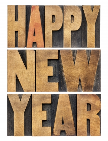 Happy New Year greetings or wishes - isolated text in vintage letterpress wood type blocks Stock Photo - 22443325