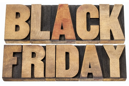 Black Friday is the day following Thanksgiving Day in the United States, often regarded as the beginning of the Christmas shopping season.  Isolated text in letterpress wood type. photo