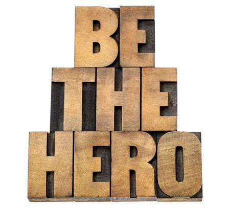 be the hero  - isolated text in letterpress wood type Stock Photo - 22443334