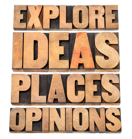 explore ideas, places, opinions - motivational advice - a collage of isolated text in letterpress wood type blocks photo