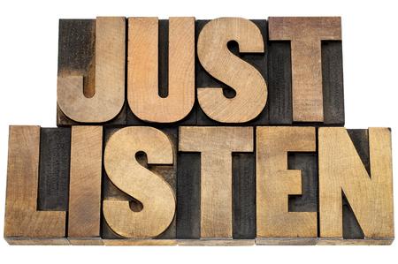 just listen advice - isolated text in letterpress wood type blocks Stock Photo - 22443340