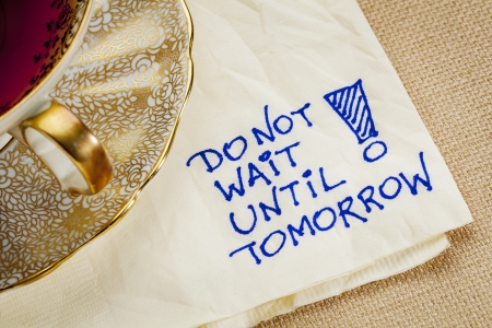 do not wait until tomorrow - motivational reminder - a napkin doodle with a cup of tea Stock Photo - 22443361