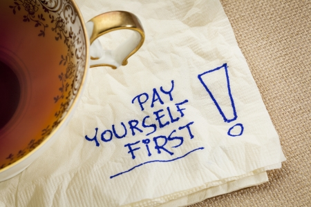 pay yourself first, a reminder of personal finance strategy - a napkin doodle with a tea cup Stock Photo - 22443364
