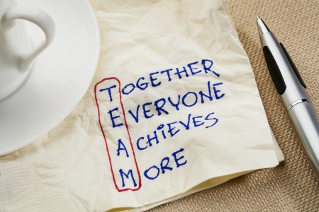 acronym: TEAM acronym (together everyone achieves more), teamwork motivation concept - a napkin doodle Stock Photo