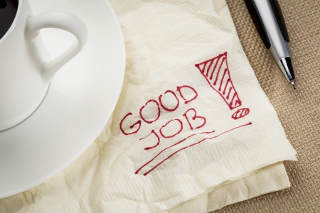 good job: good job exclamation on a napkin with cup of coffee