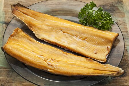 smoked trout fillet on a glass plate with parsley leaf Stock Photo - 22443377