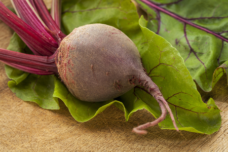 red beet root and leaves on a wooden cutting board Stock Photo - 22443403