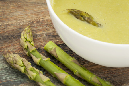 a bowl of asparagus cream soup with green asparagus spears Stock Photo - 22443411