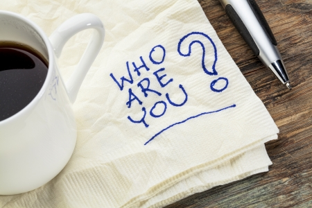 who are you question on a napkin with a cup of coffee Stock Photo - 22443414