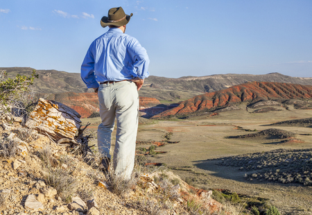 red mountain open space: male hiker contemplates a scenery of Red Mountain Open Space in northern Colorado near Fort Collins Stock Photo