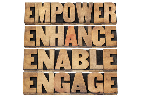 enhance: empower, enhance, enable and engage - motivational business concept - a collage of isolated words in letterpress wood type