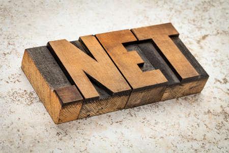 dot net- network internet domain in vintage letterpress wood type on ceramic tile background Imagens