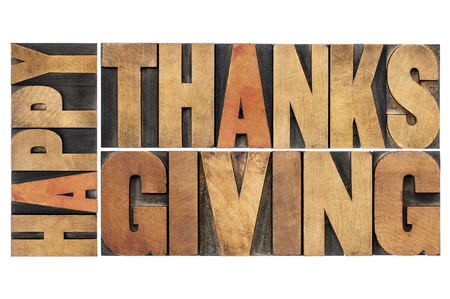 happy thanksgiving: happy thanksgiving - greetings or wishes - isolated word abstract in vintage letterpress wood type blocks Stock Photo