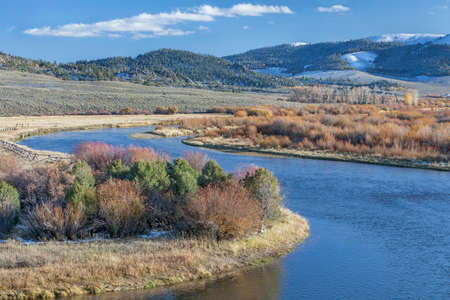 north gate: meanders of North Platte River above North Gate Canyon near Cowdrey, Colorado, in a fall scenery with some snow in surrounding mountains