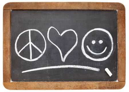 peace and love: peace, love and happiness symbols - white chalk sketch on a vintage slate blackboard Stock Photo