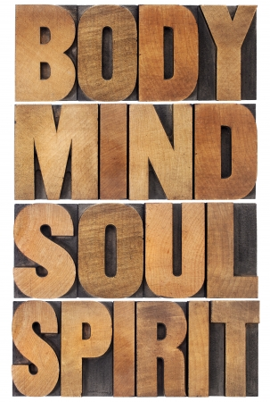 body, mind, soul and spirit typography - a collage of isolated words in vintage wood letterpress type scaled to a rectangle photo