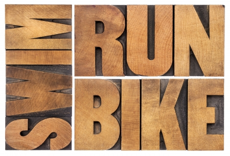triathlon: run, bike, swim - triathlon concept - isolated word abstract in vintage letterpress wood type