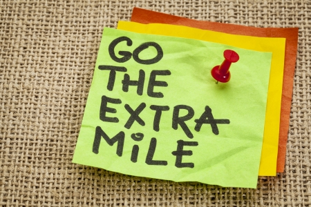 go the extra mile  - motivational reminder - handwriting on sticky note photo