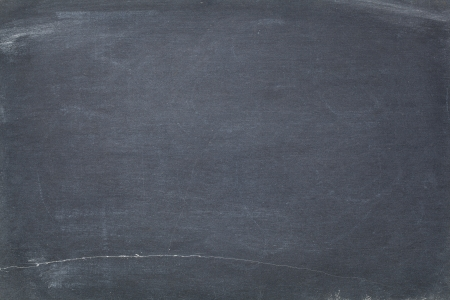 smudges: texture of vintage slate blackboard with scratches and white chalk smudges