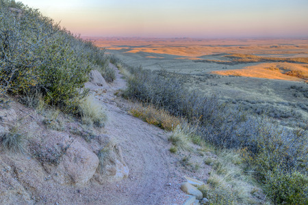 soapstone: singletrack bike trail with sunset light on rolling prairie at foothills of Rocky Mountains in Colorado - Soapstone Open Space near Fort Collins