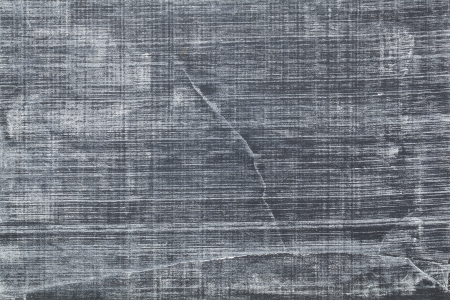 white chalk texture on vintage slate blackboard with scratches and cracks