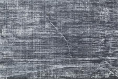 wit krijt textuur op vintage leien bord met krassen en barsten Stockfoto