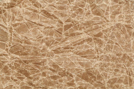 wrinkled paper: crumpled, wrinkled and creased brown wax paper background