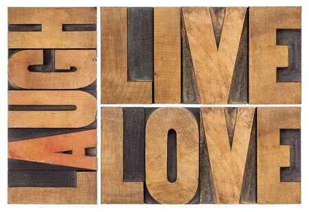 leven, liefde, lach geïsoleerde woord abstract in vintage boekdruk hout