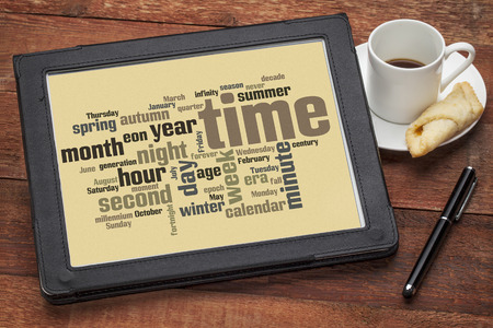 cloud of words related to time and calendar from seconds to months, years and eons on a digital tablet photo