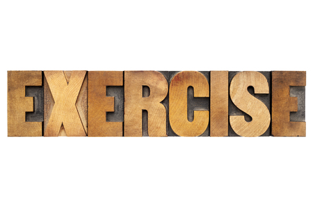exercise word - isolated text in letterpress wood type Stock Photo - 23649798