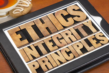 ethics, integrity and principles word abstract - ethical concept on a digital tablet with a cup of tea Banque d'images