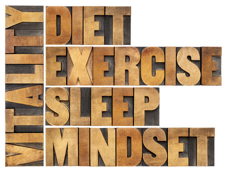 sleep well: diet, sleep, exercise and mindset - vitality concept - isolated word abstract in vintage letterpress wood type Stock Photo