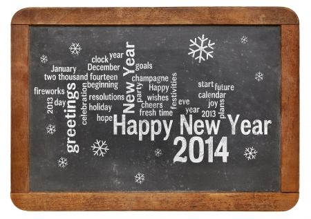 Happy New Year 2014 word cloud - white chalk text  on a vintage slate blackboard Stock Photo - 23850277