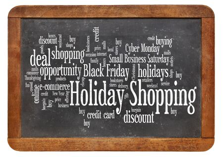 consumerism: consumerism concept - holiday shopping word cloud  on a  vintage slate blackboard isolated on white Stock Photo