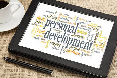 cloud of words or tags related to personal development on a  digital tablet photo
