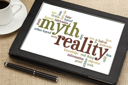 reality: cloud of words or tags related to myth and reality on a  digital tablet