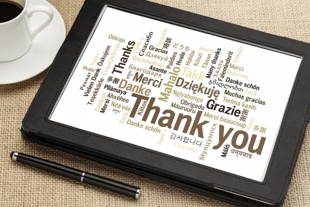 thank you: thank you in different languages - word cloud on a  digital tablet