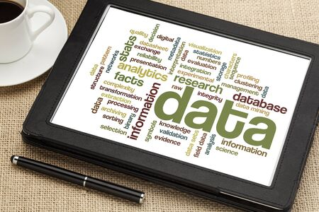 validation: data and information data cloud  on a digital tablet with a cup of coffee Stock Photo
