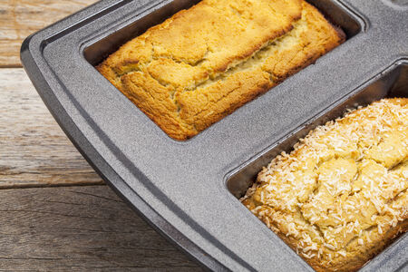 freshly baked two mini loafs of gluten free coconut flour bread in baking pan Stock Photo