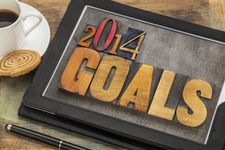 2014 goals - New Year resolution concept - text in vintage letterpress wood type on a digital tablet screen photo