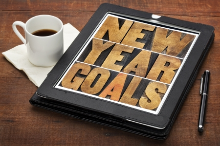 New Year goals - resolutions concept - text in vintage letterpress wood type on a digital tablet screen photo
