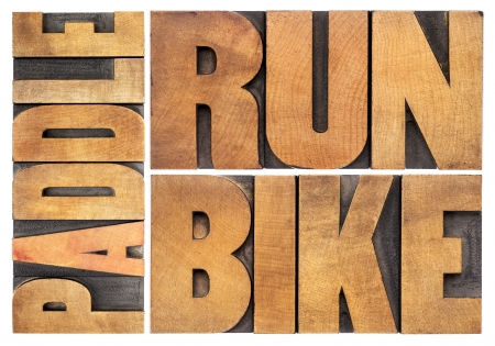 run, bike,  paddle - triathlon or recreation concept - isolated word abstract in vintage letterpress wood type photo