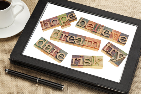 dream, hope, believe, dare, risk, try - a set of motivational and spiritual  words in vintage wood letterpress printing blocks on a digital tablet Stock Photo - 24384262